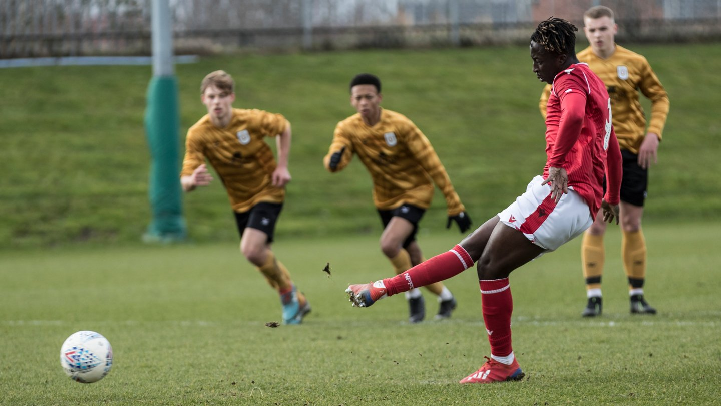 Gomis brace extends Under 23s'  lead at the top